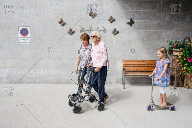 Three generations of female family together at a retirement home