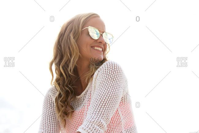 Beautiful blonde woman in reflective sunglasses