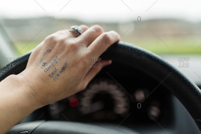 Shopping list written on driver's hand