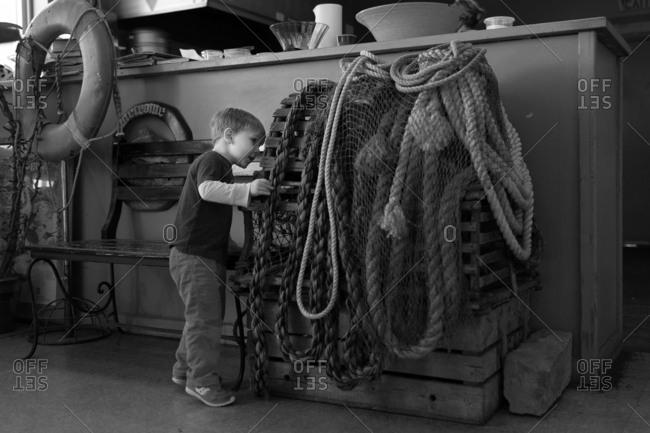 A boy examines lobster traps