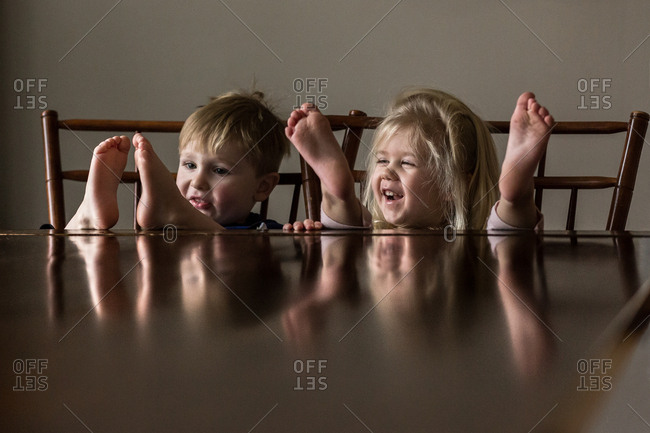 Boy and girl playing at the table