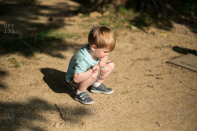 Boy playing in dirt