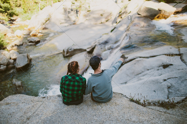 Man and woman overlooking waterfall