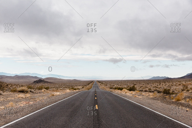 Two lane highway running through desert