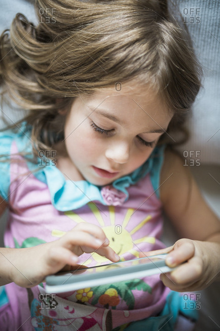 Girl holding smartphone and touching screen