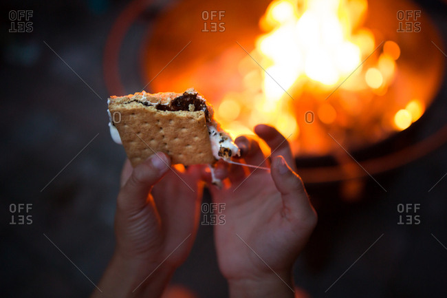Child holding a smore in hands