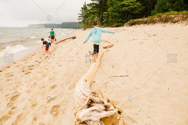 Family walking along Lake Superior beach