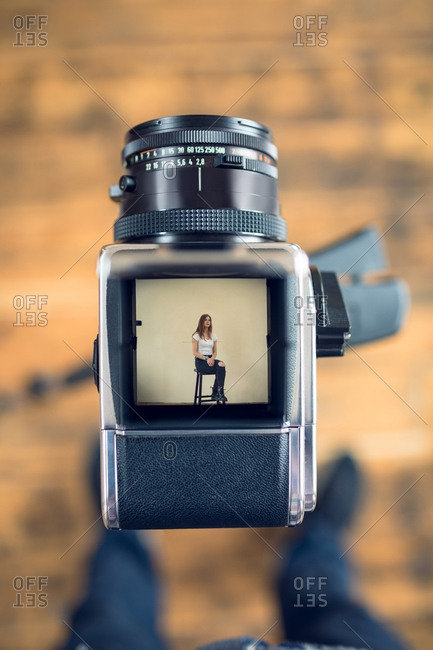 Low section of photographer standing  by camera in studio