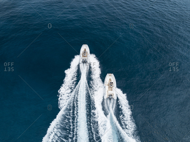 Overhead view of speedboats in blue water