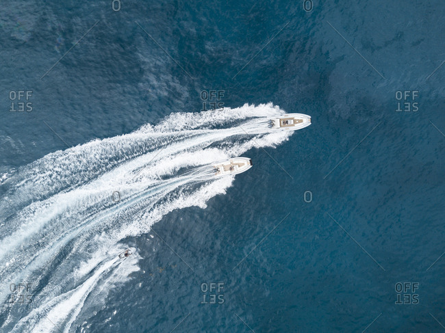 Speedboats and personal watercraft turning on water