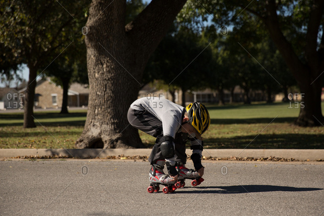 Young boy on roller skates in street