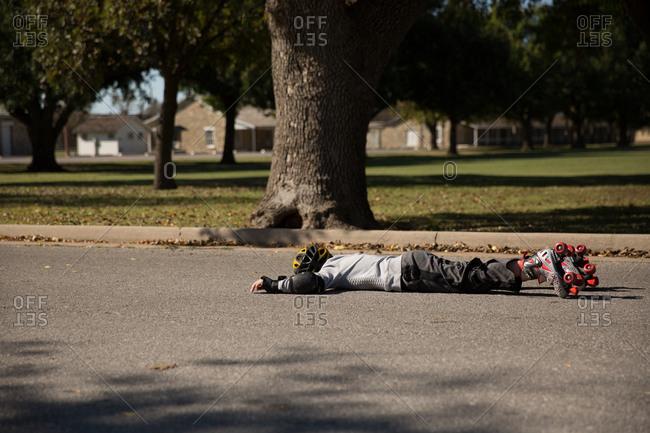 Fallen boy on roller skates
