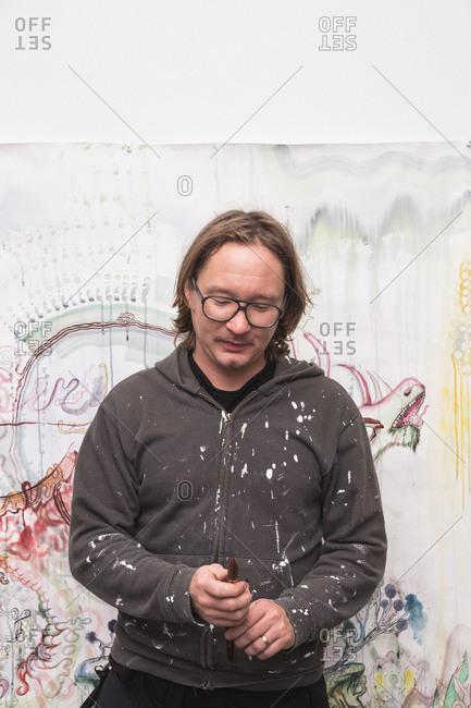 Creative male artist working in his workshop