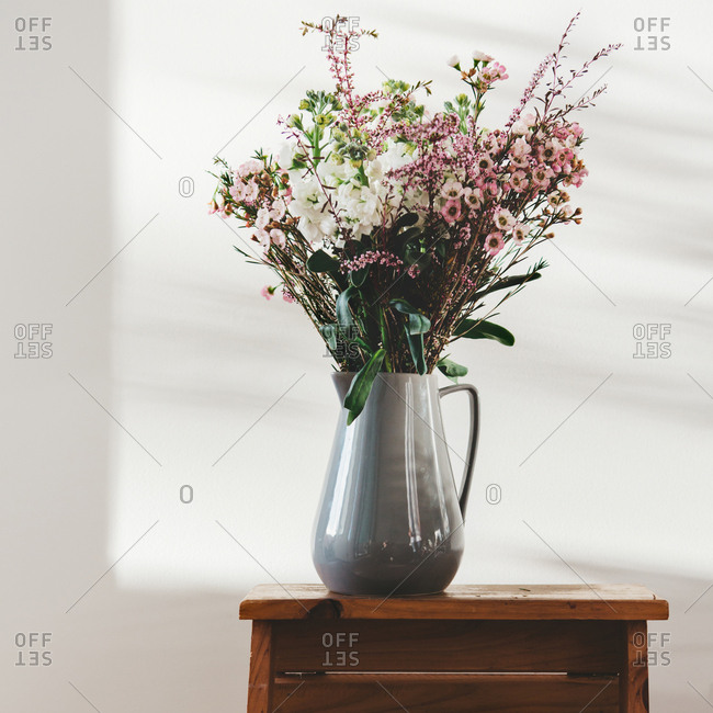 Australian native flowers in a grey jug vase with beautiful window light