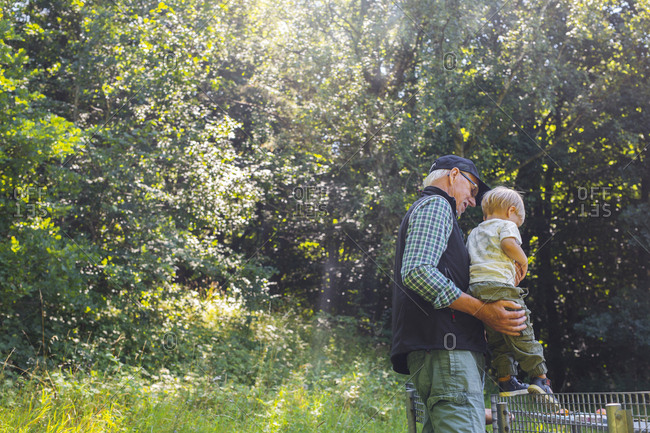 Man holding grandson (2-3)