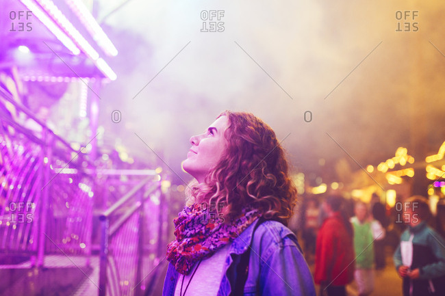 Beautiful woman looking up during festival