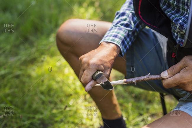 Man sharpening stick