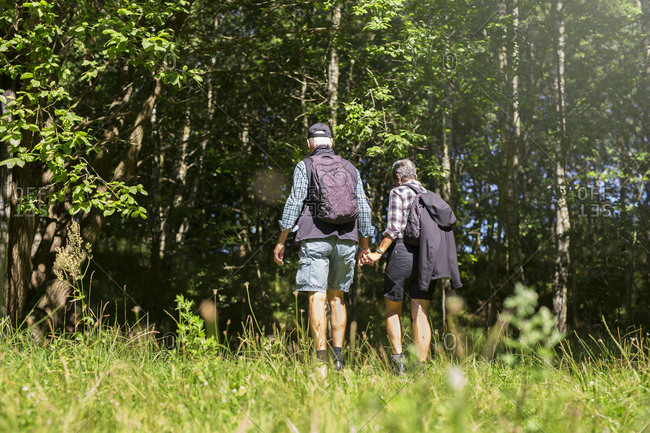 Man and woman walking in meadow