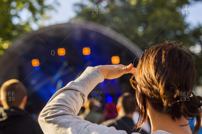 Woman watching at stage during festival