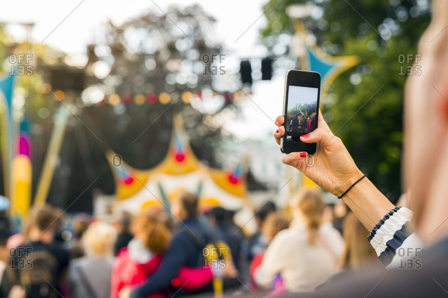 Woman photographing festival with smart phone