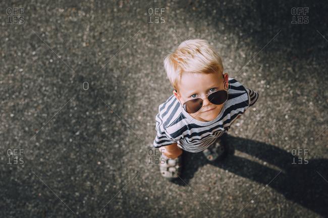 Little boy looking up wearing sunglasses