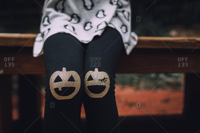 Little girl wearing Halloween leggings