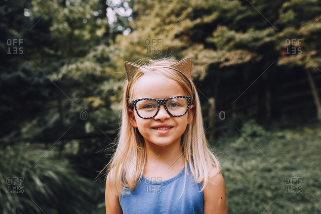 Girl wearing glasses smiling for portrait