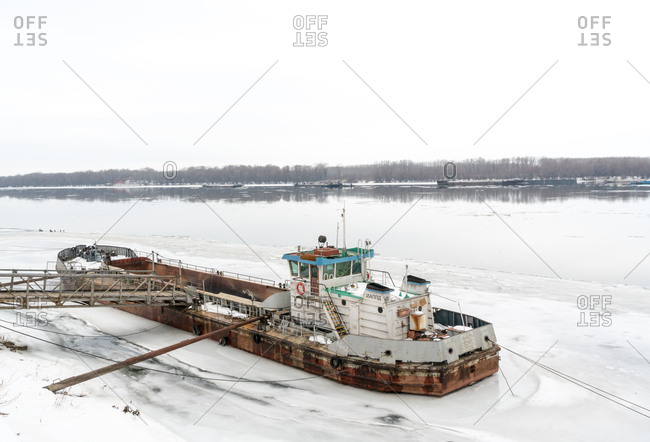 Ruse, Bulgaria - February 5, 2017: A barge stranded on the frozen Danube River