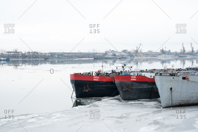 Ruse, Bulgaria - February 5, 2017: Three barges stranded on the frozen Danube River