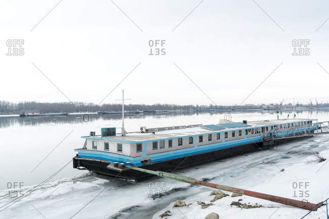 Ruse, Bulgaria - February 5, 2017: A barge stranded on the almost completely frozen Danube River