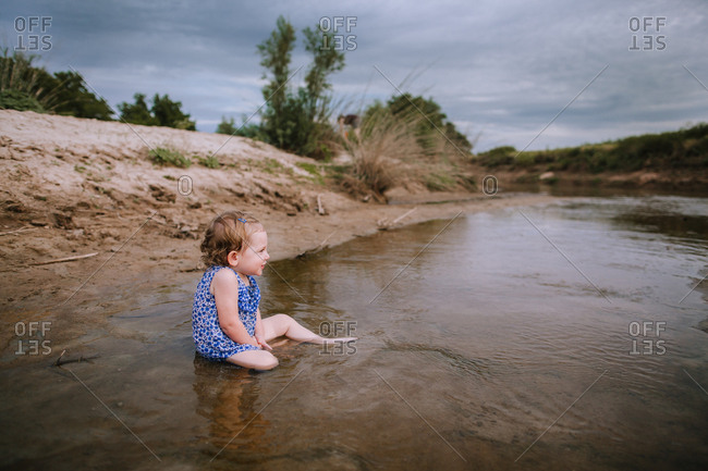 A girl playing in a river