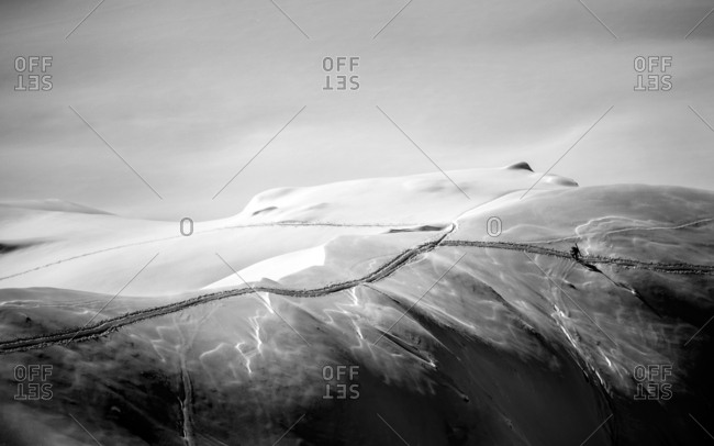 Austria, Arlberg - February 22, 2014: A breathtaking view on the Arlberg where a skier is fighting his way through the deep snow. The mountain range is located between Vorarlberg and Tyrol