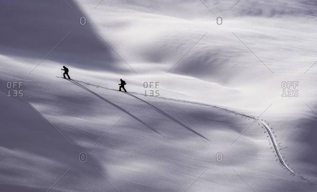 Austria, Matrei - January 6, 2014: Two cross country skiers in open snow landscape in Matrei in East Tyrol