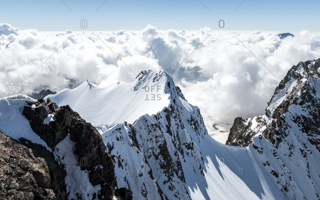 Switzerland, Piz Bernina - October 4, 2014: A breathtaking view of the Piz Bernina. which is the highest point of the Bernina Range and the highest mountain in the Eastern Alps. The mountain is located south of Pontresina and near the major Alpine resort of St. Moritz, in the Engadin valley