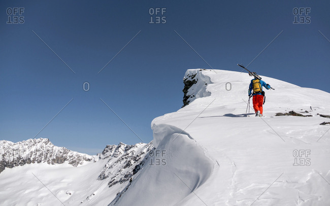 Austria, Ankogel - March 30, 2014: A skier walks the Ankogel mountain, which is located between the federal states of Salzburg and Carinthia