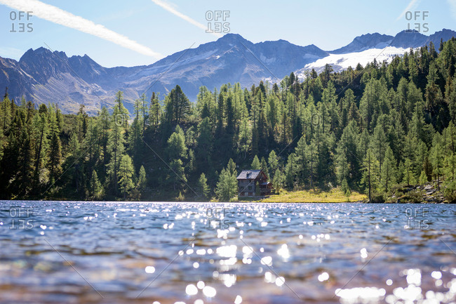 Austria, Lake Reedsee - August 30, 2015: Crystal clear water in the mountain lake Reedsee in Bad Gastein. The area is popular for hiking, picnic and fishing