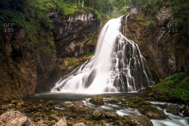 Austria, Golling - June 21, 2015: Impressive wild nature and a beautiful waterfall near Golling in the Bluntau Valley