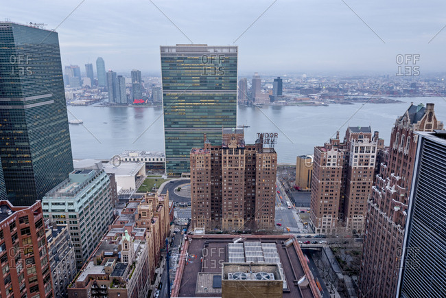 New York City, USA - April 5, 2017: A rooftop view of the United Nations building and the East River in New York City