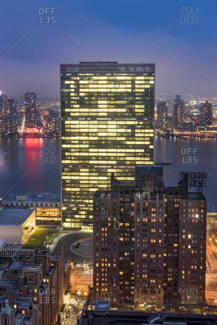 New York City, USA - April 5, 2017: A rooftop view of the United Nations building and the East River in New York City at night