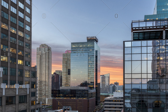 Layers of glass buildings during sunset