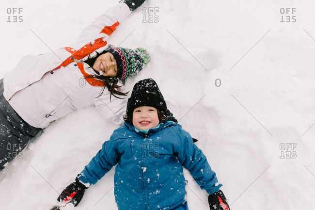 Kids make snow angels