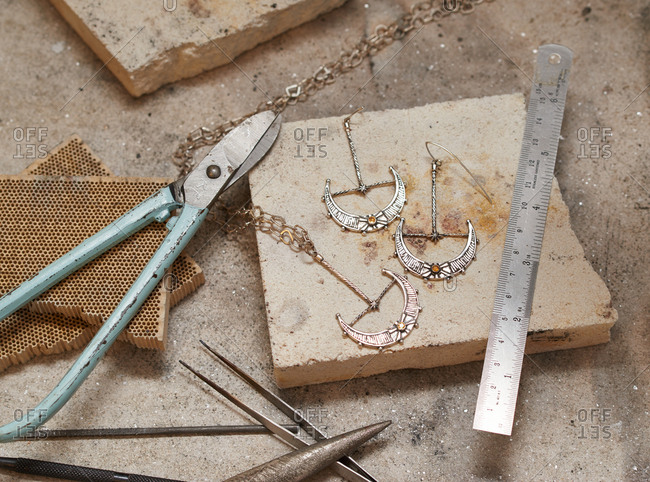 London, England - December 15, 2015: Handmade jewelry and jeweler's tools on a workshop table