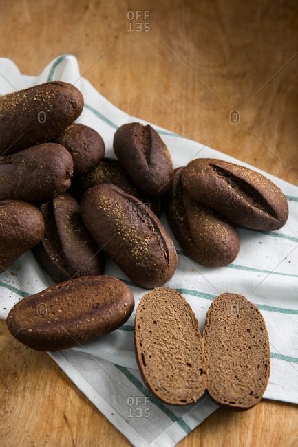 Dark bread rolls on cutting board