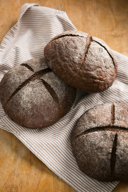 Round dark bread with scored tops
