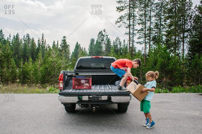 Boys loading a box into truck