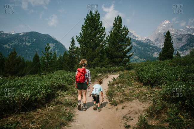 Mom hiking with boy in mountains