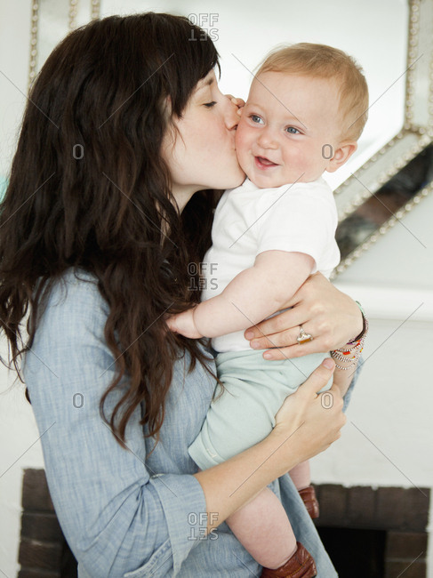 Young mother embracing baby boy (6-11 months)