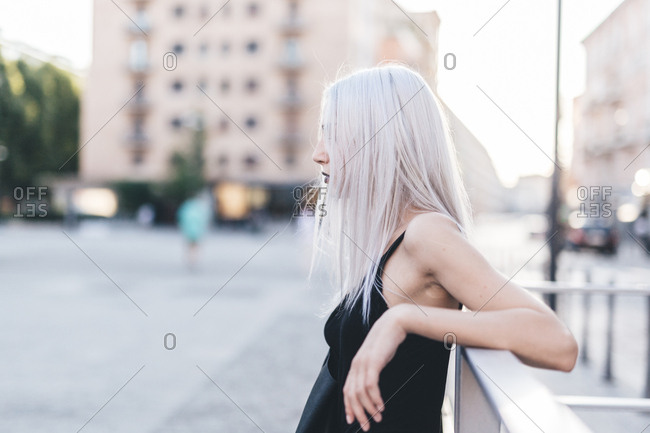 Young cool woman in the city at sunset