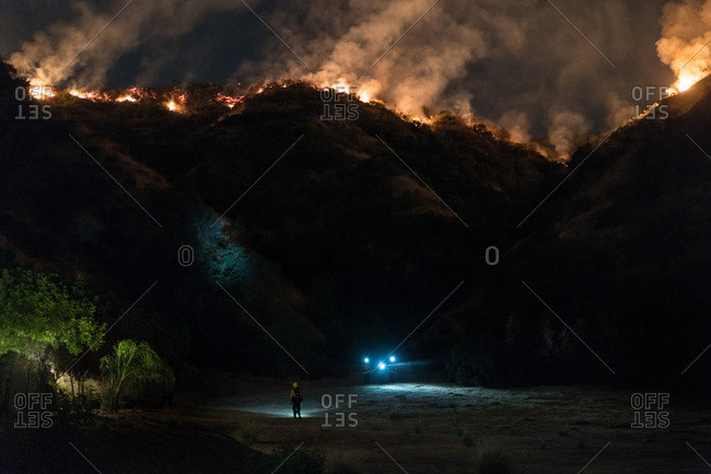 Firefighters clear an area before mandatory evacuations as the La Tuna Canyon fire advances towards homes in Burbank, CA.