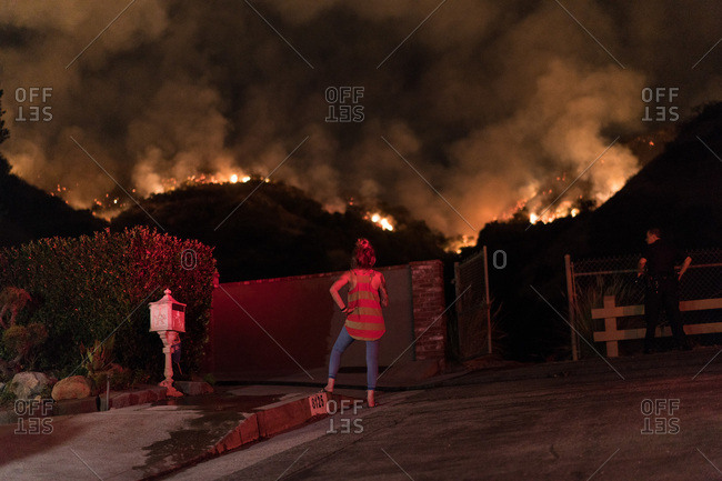 A resident in Burbank, CA watches flames advance near homes from the La Tuna Canyon fire.